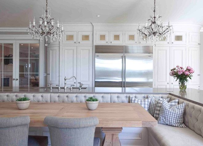 Kitchen island with gray quartz countertop and Banquette.