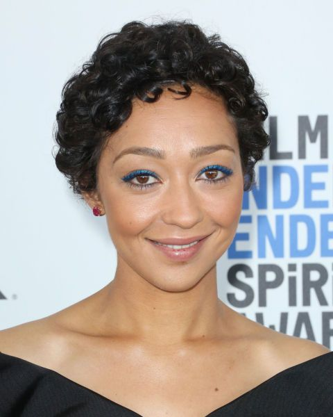 Proving short hair can be curly too, Ruth Negga looks chic rather than cherub.