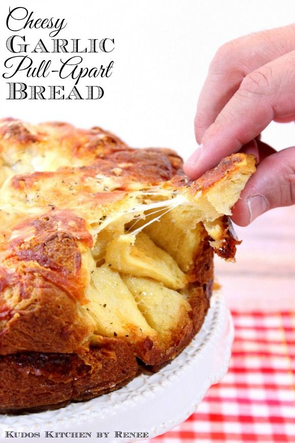 Cheesy Garlic Pull-Apart Bread bakes in a springform pan which makes for a very delicious presentation. - Kudos Kitchen by Renee