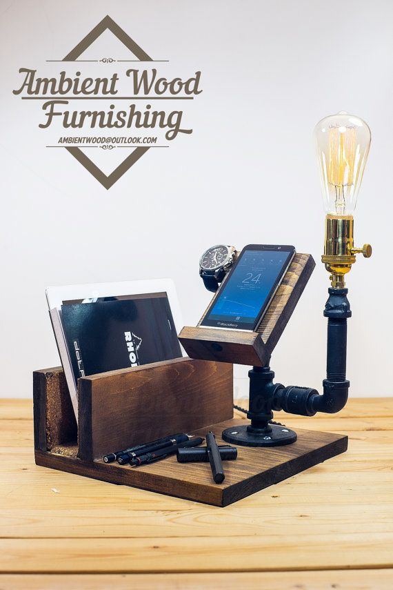 Here we incorporate our signature industrial lighting with phone & watch docking station. Serve as a perfect piece for your desktop display or bedside ambient luminance. Roughly sanded wood plate and solid metal pipe frame gives a strong industrial accent and high quality brass socket brings back great details.  Display phone model is iPhone 6, pre-drilled hole for charging cable Apple Watch hole for charger. The hole made for it is for ONLY the original regular charger we have the charger…