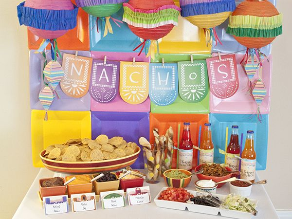 """Let's Fiesta"" :: Piggy Bank Parties Colored Plates + Fiesta Banner + Pinata Favor Boxes = Festive Backdrop #paperplatebackdrop"