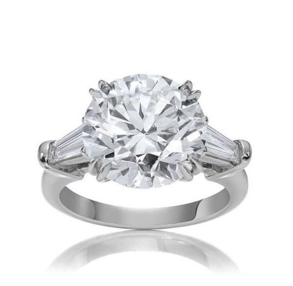 Classic Harry Winston engagement ring with round brilliant-cut colorless diamond and tapered baguettes