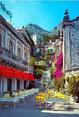 Taormina, Italy- when we do make it over there, I want to take the time to see the countryside, small towns, piazzas!  Sights, tastes, smells, history!