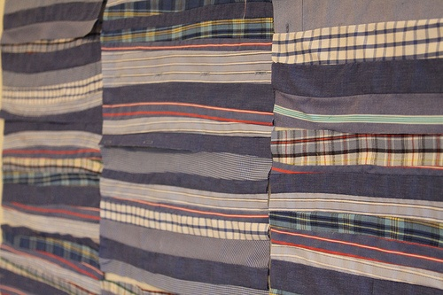 This is a section of a strip quilt made by cutting up strips of men's shirts.  I like the masculine but creative quality to it.