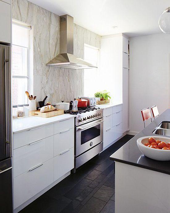 Floor tile, white cabinets, backsplash.