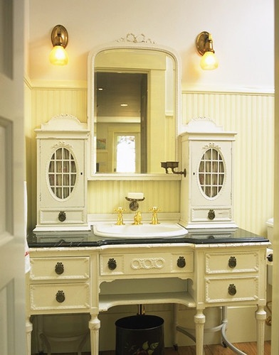 Antique vanity / buffet cabinet is reborn as a bathroom sink cabinet with lots of storage...