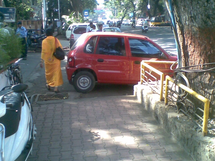 In Pune, a common practice of Parking the vehicles on footpath