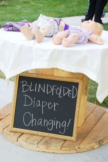 Fun baby shower game- Im pretty sure I could do this. Changing diapers in the middle of the night, half asleep, is probably the same thing.