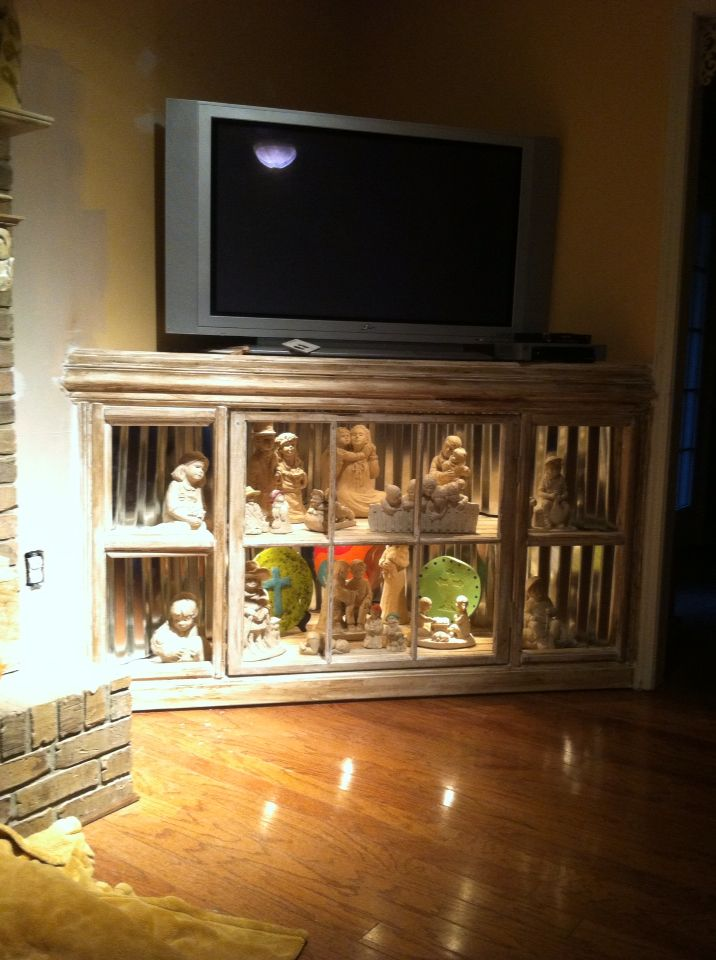 Entertainment center I made used old window as door backlit with 6- halogen lights. Floors made with tongue and groove wall boards and background is tin. Just need to paint walls and add glass at openings. I built for my wife to display her Austin sculptures that I give to her over the years for her birthday or any special occasion.