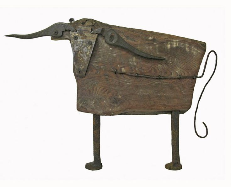 bull 3 - sculptures from recycled materials All my creatures are made of an old stable floor boards (1795) and tools, that are not used anymore. by Pina Macku