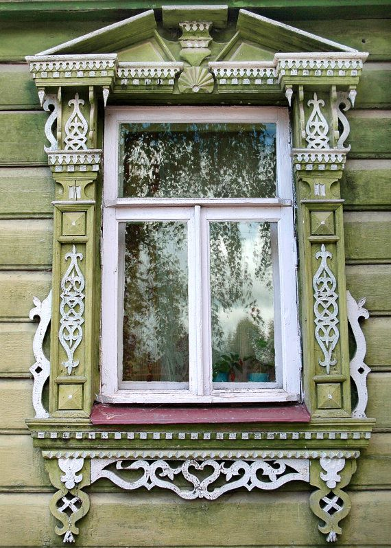 Decorative Russian Window. Woodwork. Dacha, cabin. Ancient architecture. photography. Green, pink, lace. Russia.