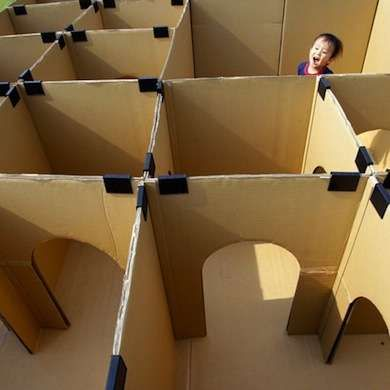 Giant people maze!  Cardboard and binder clips...