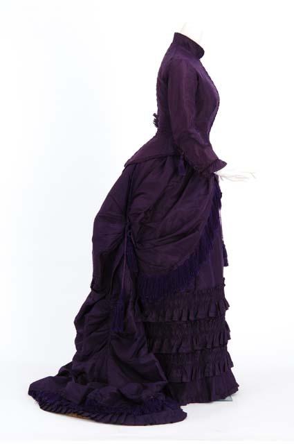 ca. 1880, Royal purple silk taffeta bustled dress. Wedding dress of Anna Malcolm Agnew Davis (Mrs. Cushman K. Davis), attributed to the Christianson sisters, dressmakers of Minneapolis, Minnesota.