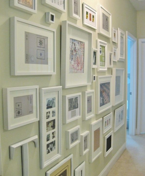 Wall Art Ideas | Tips for Hanging, Arranging | Laurel Home | wonderful and affordable way to create a custom art wall in a hallway. Frames like this are available at big box stores for very little $. Inside, can be photos, mementos, postcards, prints from old books, children's artwork, greeting cards and it becomes like a personal memoir.