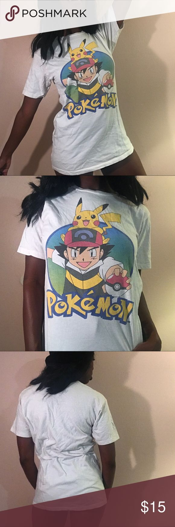 Pokémon tshirt medium ash pikachu Gotta catchem all!!! Awesome Pokémon tshirt. Size medium. A little faded but still colorful! DM TO PURCHASE!!! #pokemon #ash #pikachu #evolve #pokemongo #tvshow #cartoon #anime #kidsshow #adultshow #television #90s #90stv #shirt #t #blouse #unisex #clothing #forsale #vintage #retro #depop #poshmark #ebay #vinted #luxury #expensive #smallbusiness #blackowned #comiccon Shirts Tees - Short Sleeve