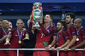 Portugal's forward Cristiano Ronaldo lifts the trophy as he celebrates with teammates Portugal's forward Ricardo Quaresma Portugal's defender Pepe...
