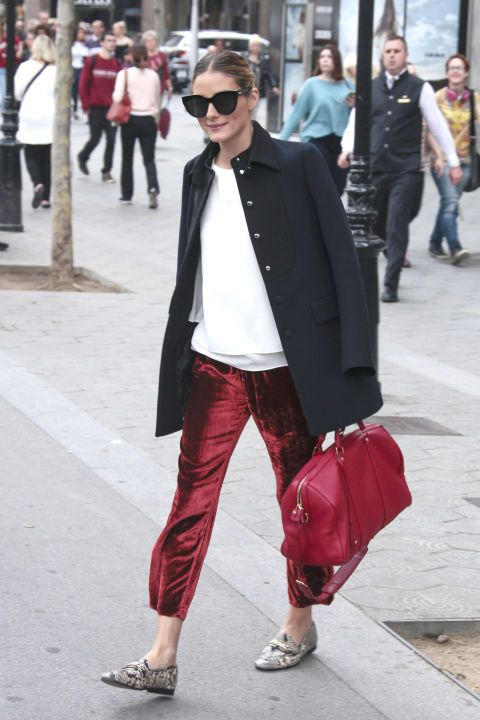 12 chic winter outfit ideas to inspire your look this season: Olivia Palermo in red velvet pants, a white sweater and black coat