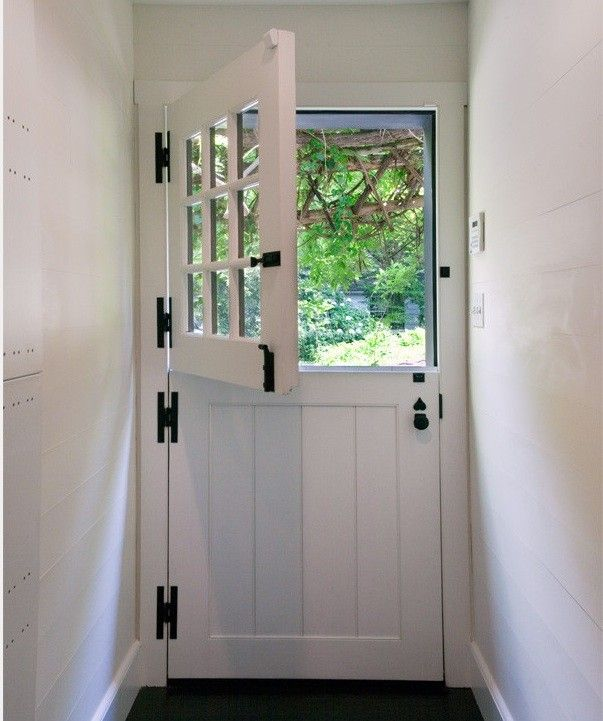 This traditional Dutch door with a paned top half has four sturdy hinges, a heavy-duty Dutch door bolt, a classic knob with lock, and a deadbolt on the upper half.