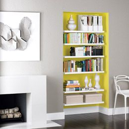 I love the grey wall, with the pop of bright yellow for a hidden shelving unit.