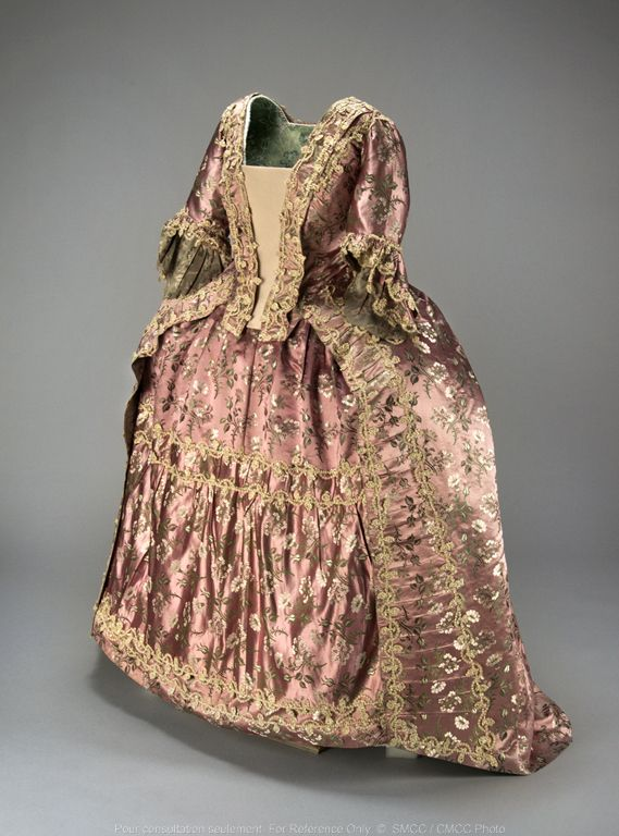 Robe à la francaise, England, c. 1760-1770. Pink-purple satin brocade with a pattern of floral sprays worked in white and green.