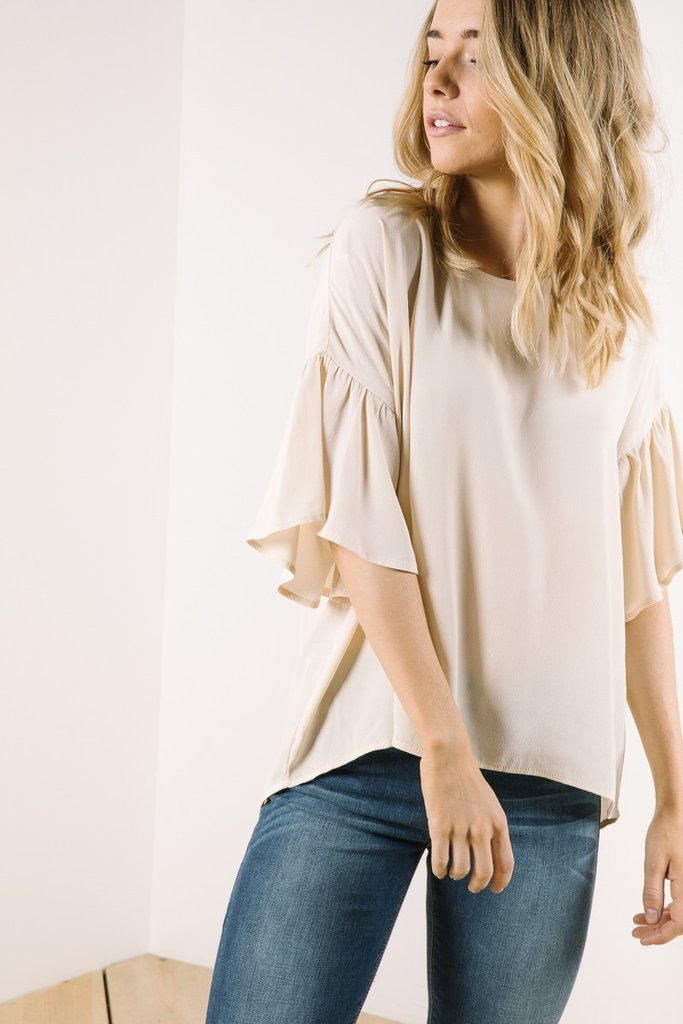 You've seen peplum blouses, but have you ever seen peplum sleeves? The Truffle Peplum Sleeve Blouse is an effortlessly sophisticated top to pair with jeans or overalls. Model is wearing a small 100% p