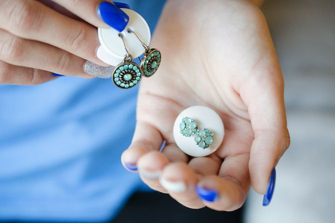 1. Keep a pair of earrings together with a button.