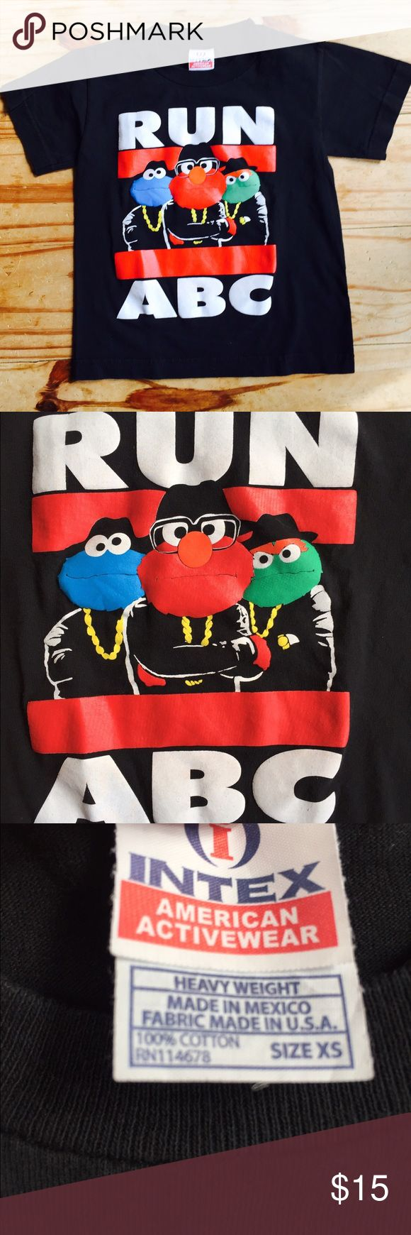 RUN-ABC Sesame Street Tee Perfect condition - washed but never worn! Black 100% cotton short sleeve t-shirt with RUN-ABC logo featuring Elmo, Cookie Monster and Oscar the Grouch from Sesame Street. Perfect for your mini hip hop fan! Size XS (seems comparable to a 5T in most brands). Shirts & Tops Tees - Short Sleeve