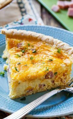 Easy Ham and Cheese Quiche- great way to use up leftover ham! Ingredients •1 tablespoon butter •½ medium yellow onion, chopped •4 eggs, lightly beaten •1 cup half-and-half •¼ teaspoon salt •¼ teaspoon black pepper •1½ cups diced ham •1 cup shredded swiss cheese •1 cup shredded cheddar cheese •1 frozen pie crust