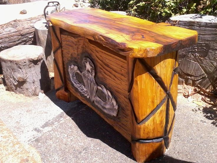 Outside bbq table or bar master jump wings chainsaw carved