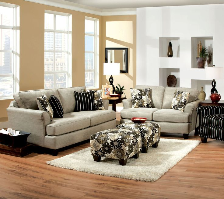 SOFA SM5042-SF CARDIFF COLLECTIONAdd this sophisticated sofa set to your living room and enjoy the comfort and style it will bring to your home. Elegant pewter fabric complements the contrasting fl oral pattern on the pillows, ottoman, and matching chair.• Transitional Style • Plush Cushions • Pillows Included • Pewter