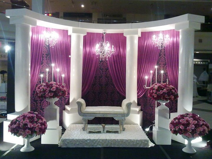 purple and white head table for a bride and groom, wedding reception decor