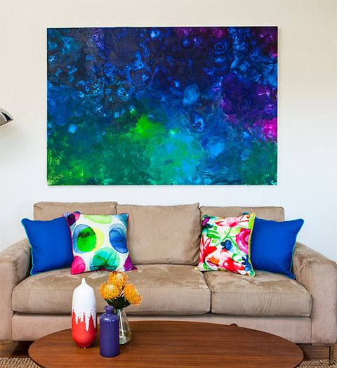 There's more than one way to paint a canvas - try painting with wax! Melt crayons and spread them on a large canvas for a magical effect.