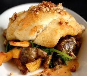 Light and healthy baked halibut with vegetables.