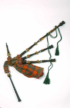 Set of Highland bagpipes by Thomas Glen of Edinburgh, c.1850. Laburnum chanter with silver sole and heavy ivory mount on the tenon; marked 'T. GLEN / 2 NORTH BANK ST. / EDINBURGH'. Laburnum drones, ornately turned with drone tops mounted and shaped and decorated as thistles. Sheepskin bag with Royal Stewart tartan cover. Formerly stock of J. and R. Glen, Edinburgh, or from the collection of the firm's proprietors. This set is similar to one on loan to the Morpeth Chantry Museum in…