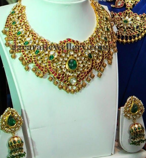 Jewellery Designs: Dancing Peacock Temple Sets