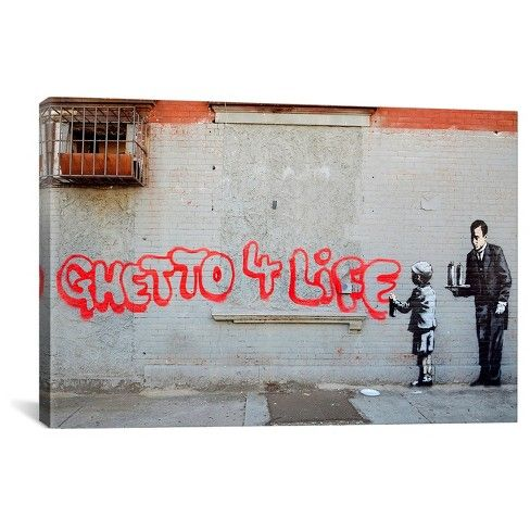 """Add an iconic Banksy print to your home with the Ghetto 4 Life by Banksy Canvas Print from iCanvas. This Banksy print features a young man spraying the words """"Ghetto 4 Life"""" in red paint across an old building while wearing his private school uniform and being attended to by his butler. Hang in your home office or study to inspire you."""
