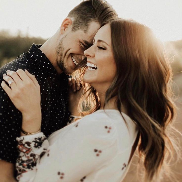 Awe that look of love and laughter. Couple laughing and sharing a tender moment. #love #engagementphotos #engagement #laughter