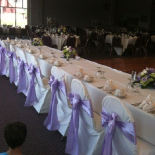 Chair Covers With Lavender Satin Sashes