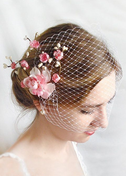 A bandeau veil is such a versatile style to wear. It can be arranged to cover half the face, or higher, so it rests just below the eyes. Use 2-3 hair pins to discreetly pin down sections of the veil, til it sits the way you want. The flower hair piece is included, and attaches separately from the veil on a hair clip. It slides into place over either of the combs. NOTE: the color you choose from the drop-down menu is the NETTING color only. The flowers will be pink, as shown.  – SIZE: veil…