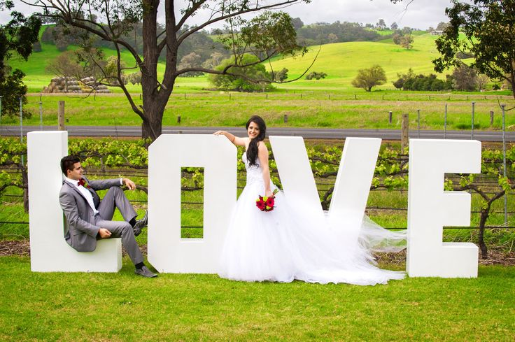 fun giant white LOVE letters from Share the LOVE in Collie. Gorgeous green countryside vineyard location is St Aidan's Winery in the Ferguson Valley in Western Australia. Photography by Henderson Photographics.