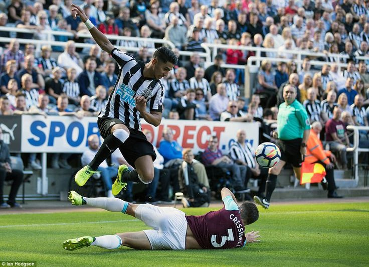 England left back Aaron Cresswell slides in for a tackle on Perez as Newcastle narrowly edged the first half advantage