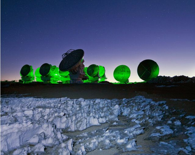 Sitting amongst the alien landscape of the harsh Atacama, the antennas of the Large Millimeter/submillimeter Array (ALMA) look eerily otherworldly in this ESO Picture of the Week as they are bathed in a neon green light. This light is actually an in-built function of ALMA, not evidence of alien activity! The array's antennas have a flashing green light that blinks periodically whilst the antennas are in operation, and does not disturb the radio-wavelength observations. This light is not…