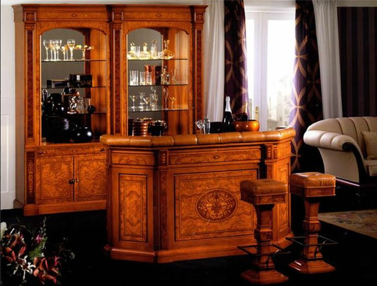 """Бар (витрина, барная стойка, барные стулья) """"Viena"""" производства испанской фабрики Vicente Zaragoza. Массив бук, клен, шпон оливкового и миртового дерева, вся инкрустация выполнена вручную из апельсинового дерева и других экзотических пород. Витрина выполнена с подсветкой. Обрамление барной стойки и сидушки стульев - натуральная кожа. Размеры: витрина - 220х45х235h, барная стойка - 189х55,5х110h, барный стул - 35х35х78h. Розничная стоимость была - 21229, акционная стоимость - 8000"""