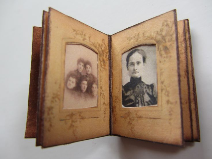 Old miniature album with old photos