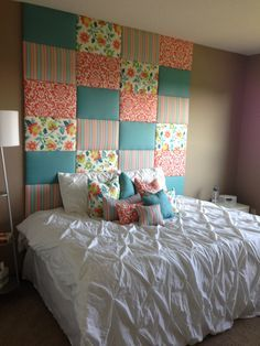 Homemade headboard is made out of plywood, batting, and fabric.