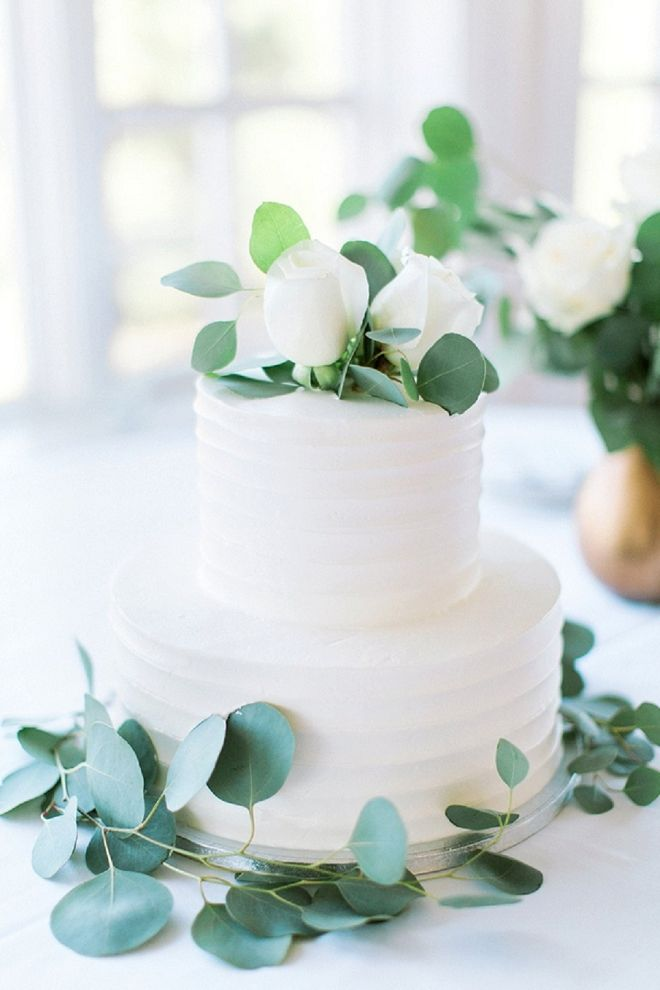 We're in LOVE with this gorgeous modern white and eucalyptus wedding cake! Beautiful San Diego wedding at Carmel Mountain Ranch Country Club