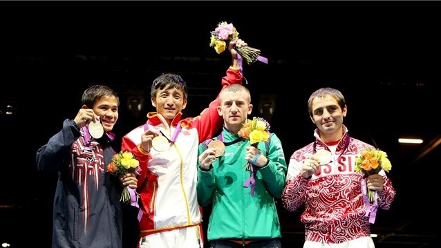 (L-R) Silver medallist Kaeo Pongprayoon of Thailand, gold medallist Shiming Zou of China, Paddy Barnes of Ireland and David Ayrapetyan of Russia celebrate on the podium during the medal ceremony for the Men's Light Fly (49kg) Boxing final bout on Day 15 of the London 2012 Olympic Games at ExCeL