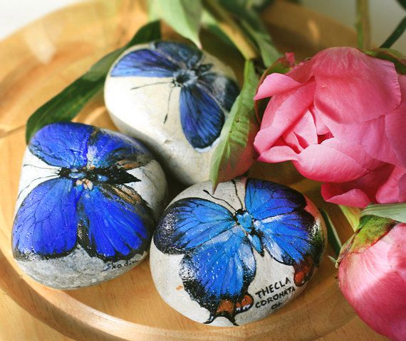 Set of three stones with a hand-painted blue by SkadiaArt on Etsy