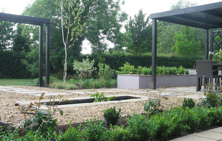 Contemporary Garden Design in Gosmore with Black Pergola and Sunken Pond