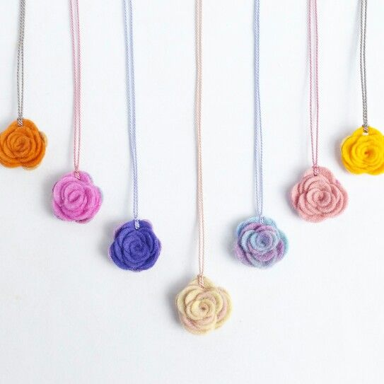 Pretty felt roses ... wear them around your neck! Hand dyed wool felt, hand rolled and strung on silk cord .... perfect length to add that something special to a t.shirt and jeans, or your favourite summer dress  ... find me on etsy www.etsy.com/shop/mimseyINC #handmadeinaustralia #etsy #gifts #madewithlove #necklace #designer #oneofakind